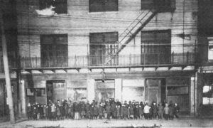 Boys line up outside the Dutton Street Club in 1920.
